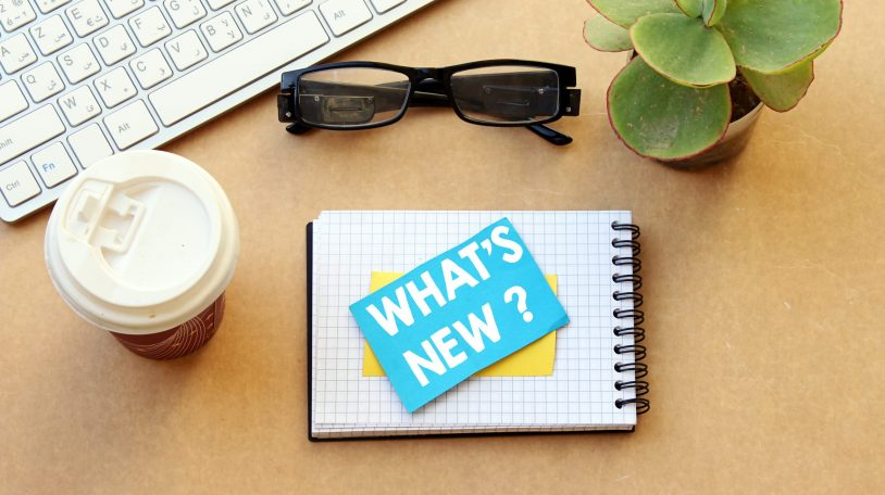 what's new ? concept, desktop: notebook, paper and disposable cup coffee, eyeglasses, keyboard, pot plant